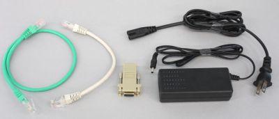 写真6 OpenBlockS 600の付属品。左からイーサネットケーブル(クロス)、イーサネットケーブル(ストレート)、RJ-45-RS-232C変換コネクタ、ACアダプタだ